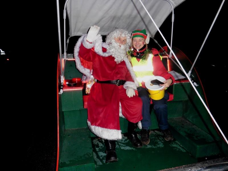 Santa & helper in his sleigh