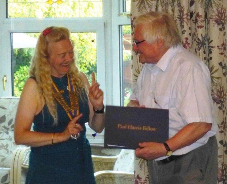 Brian Price received the Paul Harris Award from Sylvia Keris