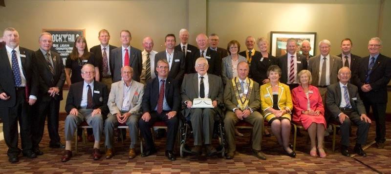 Club members congratulate Joe thomson on 60 years in Rotary