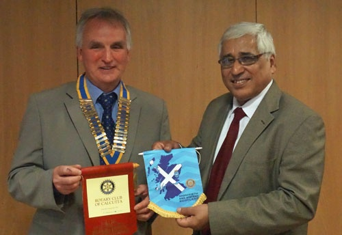President Alasdair MAcleod exchanging banners with Saumen Ray