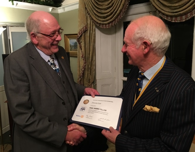 Dennis Lee being presented with his Paul Harris Fellow certificate Dec 19 2016