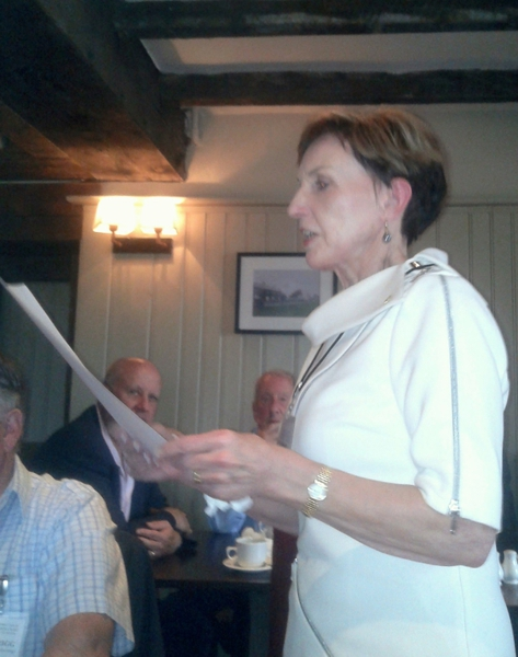 Pamela reads the objectives of Rotary