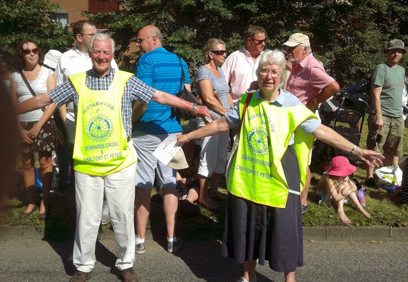 Rotarian Bill Collins and his wife Pat controlled traffic