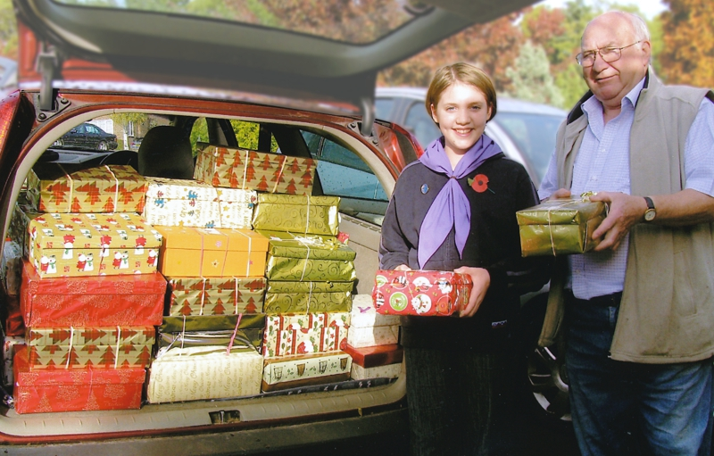 Guides helped Rotarians collect the Christmas boxes.