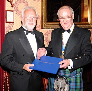 Andrew Gillies receiving award from President Alan Farquharson