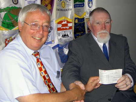 President Terry hands ?2,000 to Clive Hunt, Project Manager, The Green Hut
