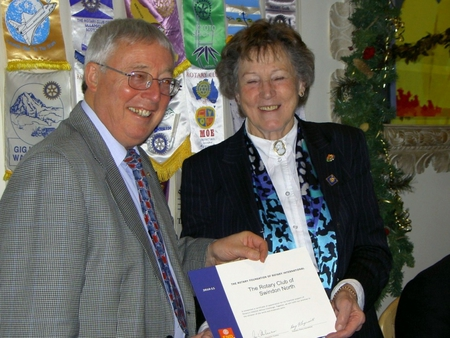 Rtn Jill presents PP Terry with the RI Certificate of Appreciation