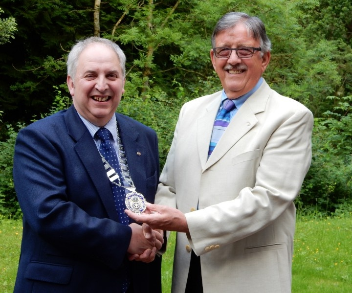 Outgoing President John Knighthand over to incoming President Jim Reid