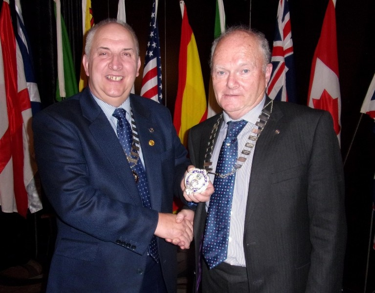 Outgoing President Jim speirs handing over to incoming President Gordon McCallum