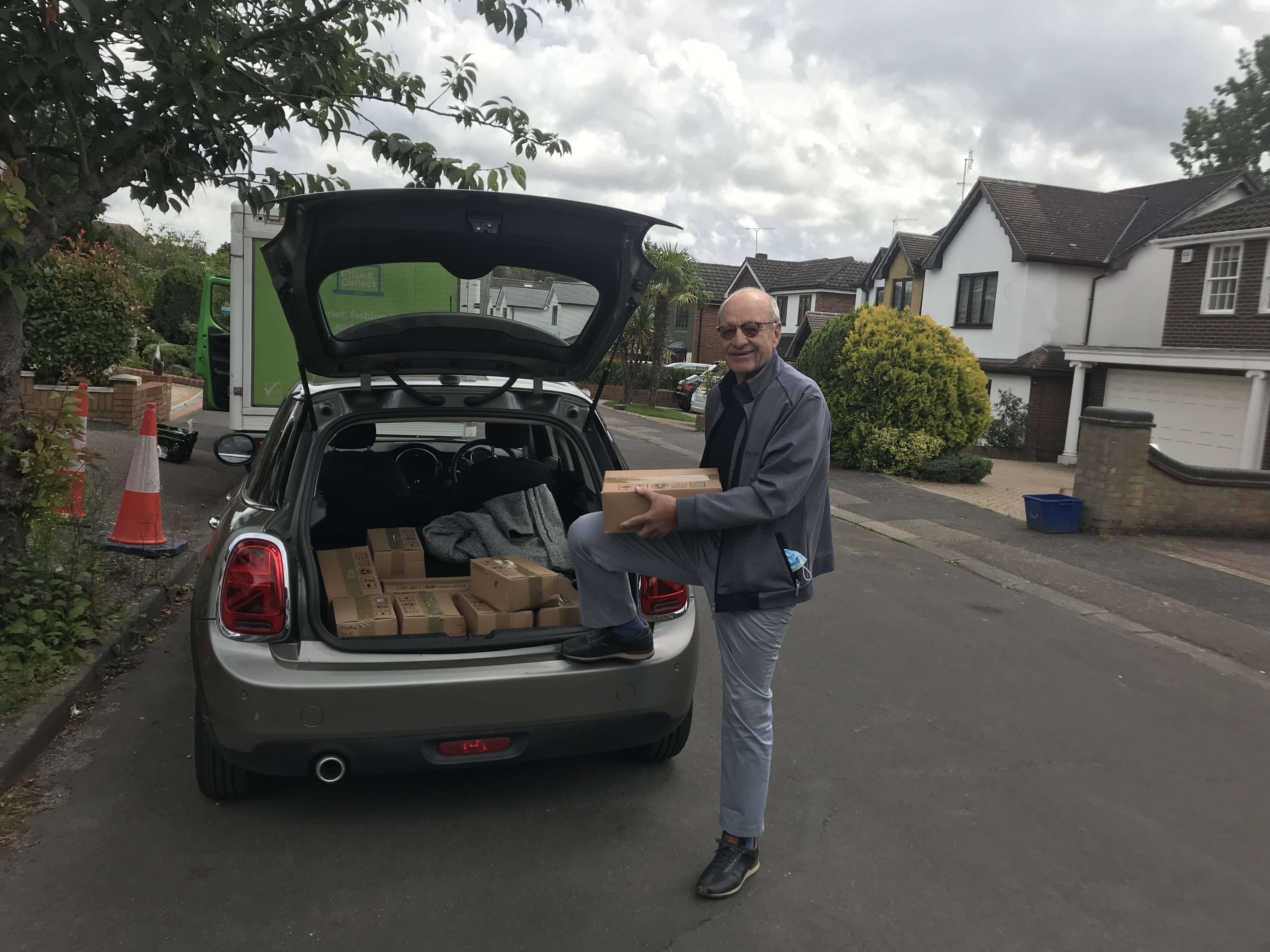 Rotarian George picks up boxes of chocolates donated by M&Ms