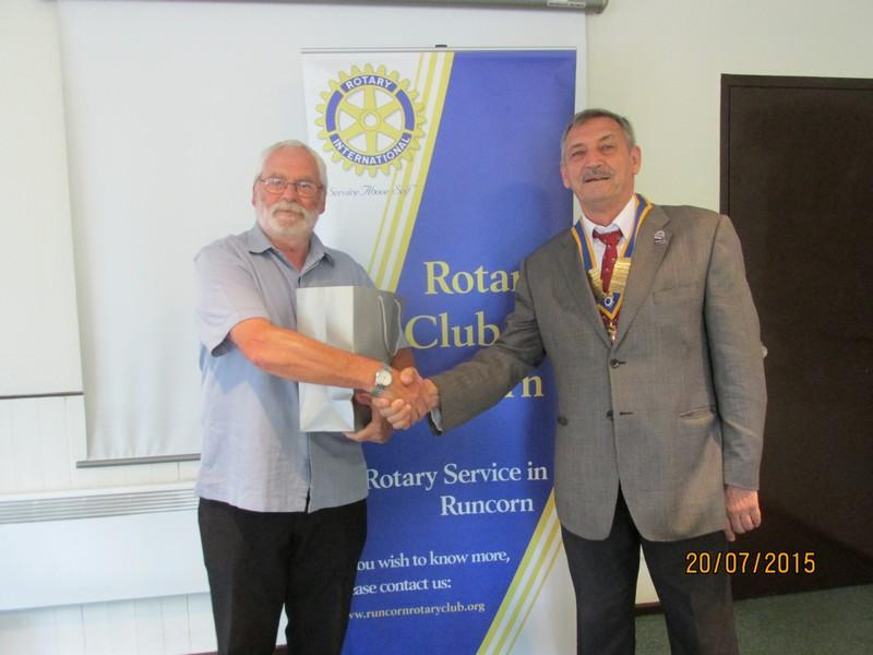 Presentations to the winner and runner up of Nearest the Pin - Norman Lightfoot receiving his prize ( 4 bottles of wine.) from this year's president Ray Clare