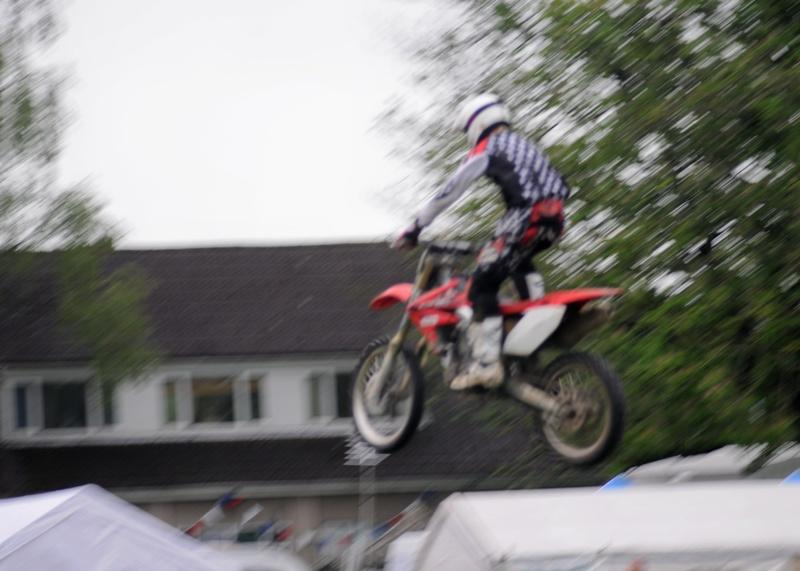 Abergavenny Steam Rally 2012 - One of the motorcycle display team jumps high over the arena.