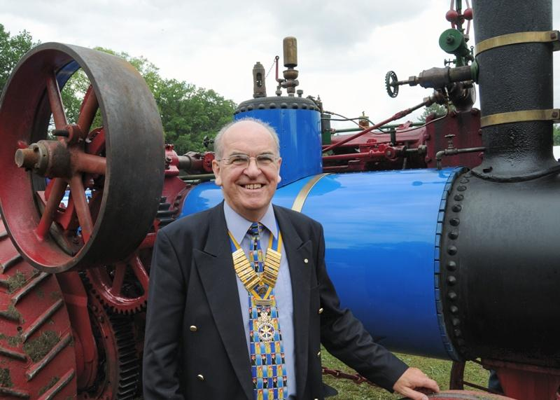 Abergavenny Steam Rally 2012 - Rotary President Brian Roussel inspects one of the Steam Traction engines