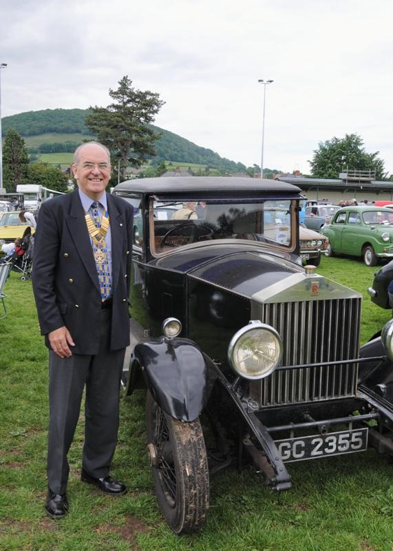 Abergavenny Steam Rally 2012 - Rotary President Brian Roussel inspects an old Rolls Royce