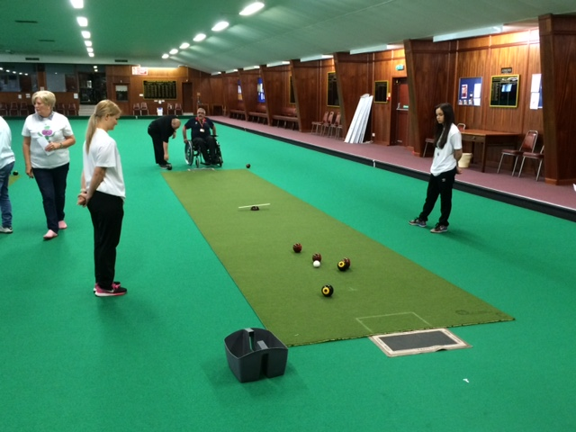 Wishaw Disabled Games 2016 - Two members of DISS, Aberdeen, compete with two members of NL Leisure scoring and Jane Allan working with adjacent carpet