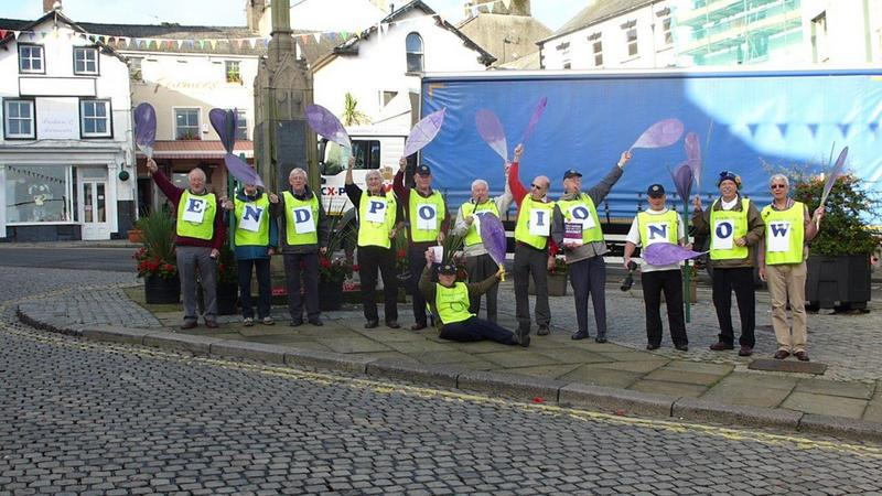 Flash Mob in Ulverston - Spelling out our message at the Market Cross in Ulverston