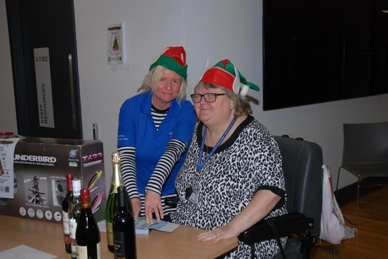 BOND LEGACY - Academy Governor Jacqui Cartwright with fellow elf Wendy Barker at the raffle desk.