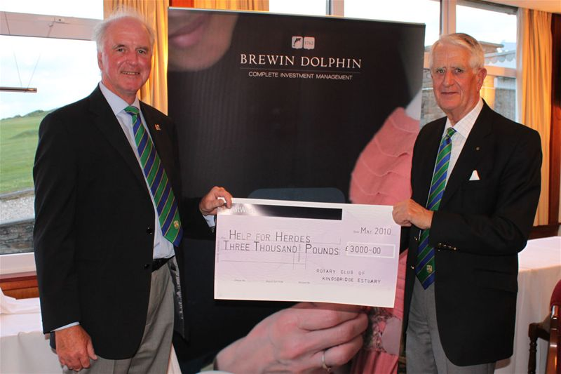 Golf Day 2010 - Brian Sheppard with event organiser Rtn Graham Worrall get a big hand with the cheque