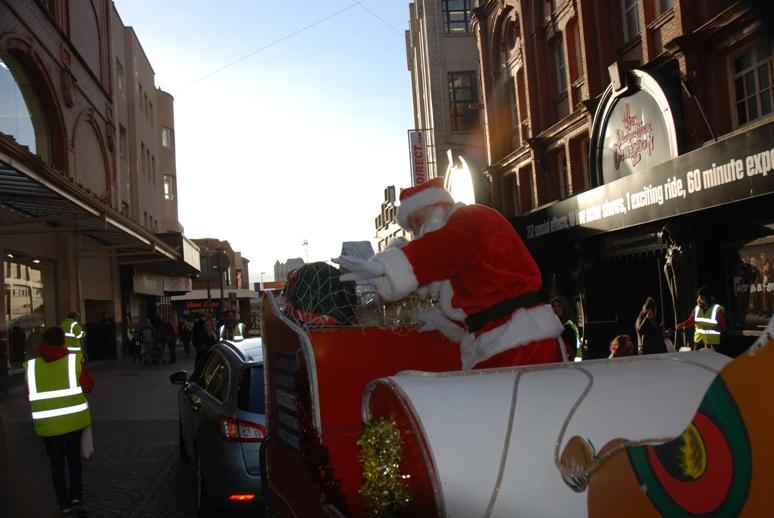 SANTA VISITS THE HOUNDSHILL CENTRE, BLACKPOOL - And he is still waving.  He really is enjoying this Parade.