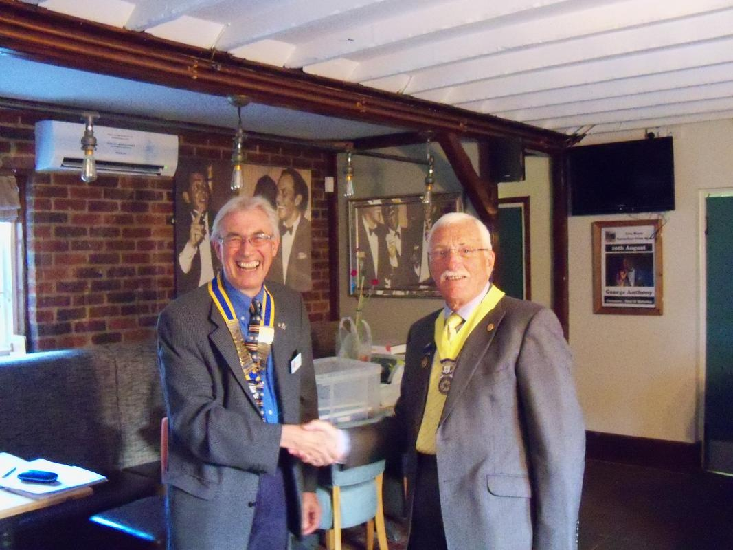 ......Handover Night..... 2nd July 2019 - President Bob Knowles presents President Elect Peter Aspinall with his regalia for the year