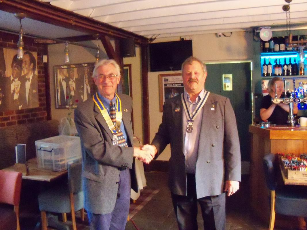 ......Handover Night..... 2nd July 2019 - President Bob Knowles presents Secretary Barry Collett with his regalia for the year