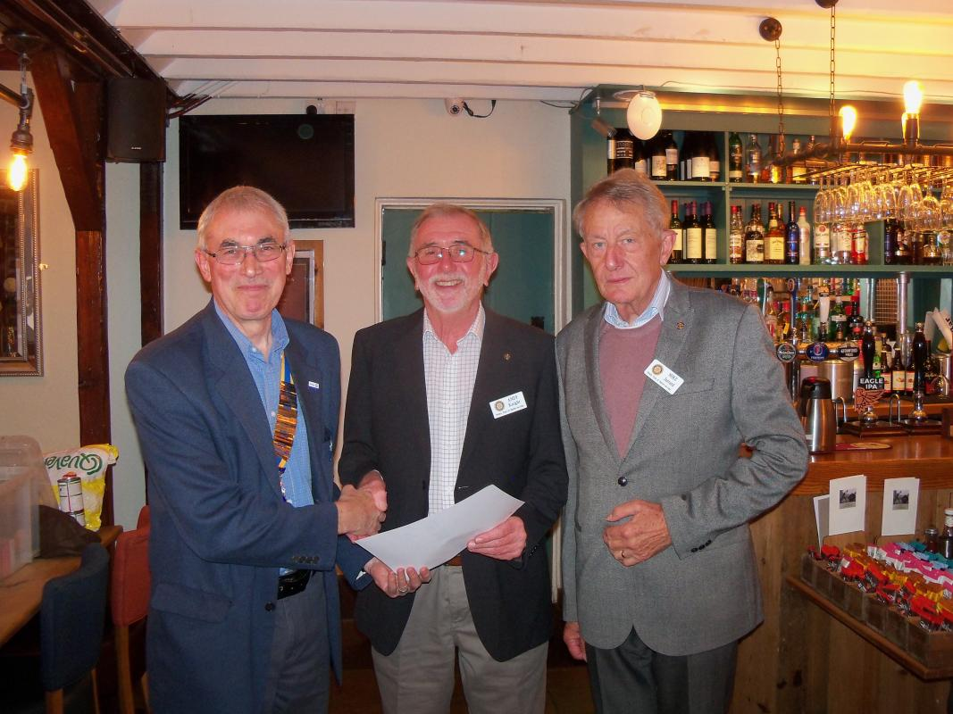 Andy Knight is inducted as a member - President Bob, Rtn Andy Knight and Rtn Mike Jarrard who proposed Andy as a new member of the Club