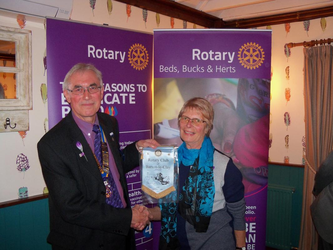 World Polio Day Thursday 24th October 2019 - President Bob presents a Club banner to District Governor Mary Whitehead