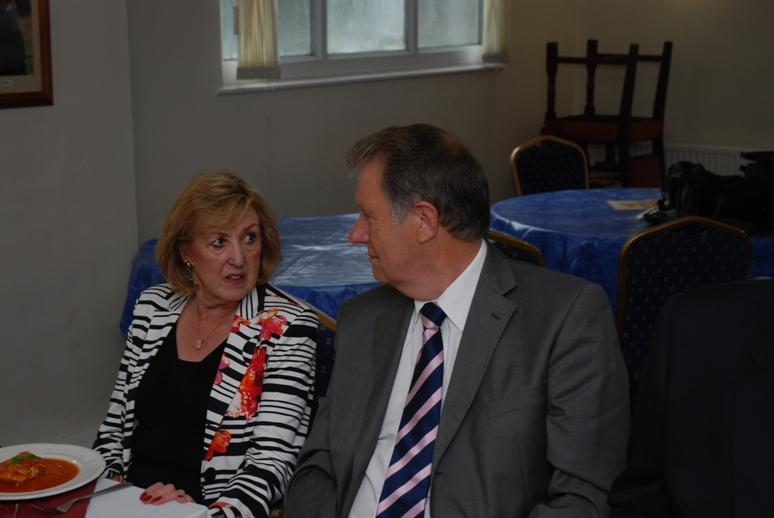 President Barbara takes over. - Looks like a serious chat between Secretary Anne Hind and former member Barry.