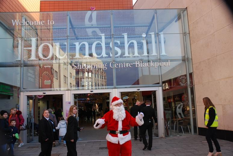 SANTA VISITS THE HOUNDSHILL CENTRE, BLACKPOOL - Santa's getting ready to enter the Centre.