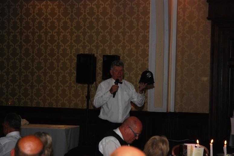 Gerry's Celebration Commemorative Dinner - Tony auctioning an old Blackpool Borough Police helmet.