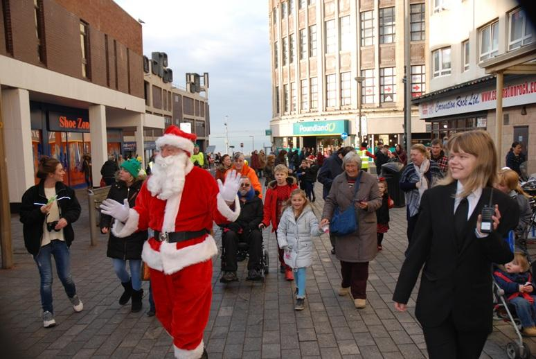 SANTA VISITS THE HOUNDSHILL CENTRE, BLACKPOOL - The crowd follows Santa.