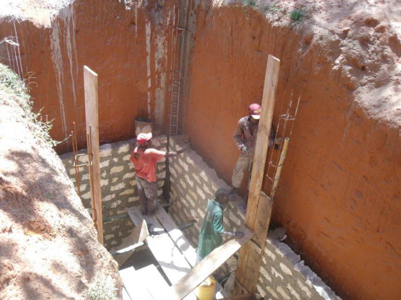 International Activities - Lining the latrine pit