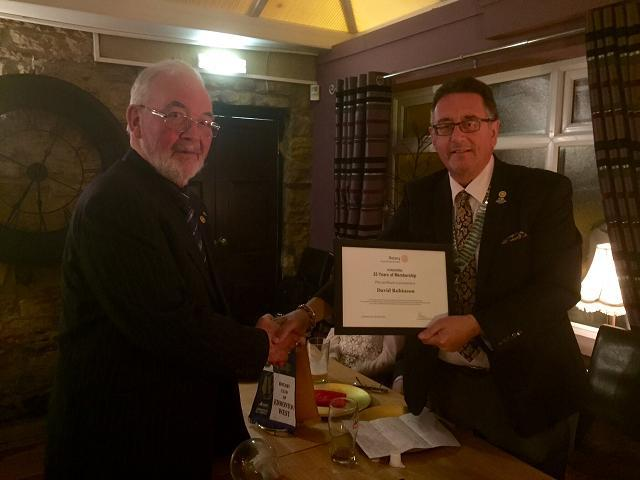 Club 25th Anniversary Meeting - DG Terry Long presents David Robinson a certificate from Rotary International to acknowledge his 25 years of  Rotary Service