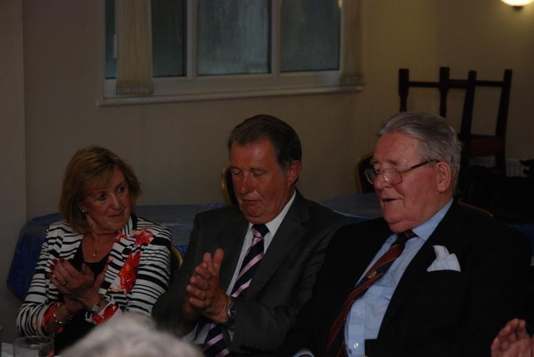 President Barbara takes over. - Anne Hind, Barry Birch and Alan Rydeheard applaud the President.