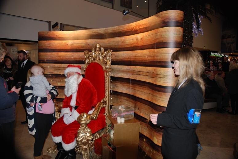 SANTA VISITS THE HOUNDSHILL CENTRE, BLACKPOOL - Santa soon had customers.