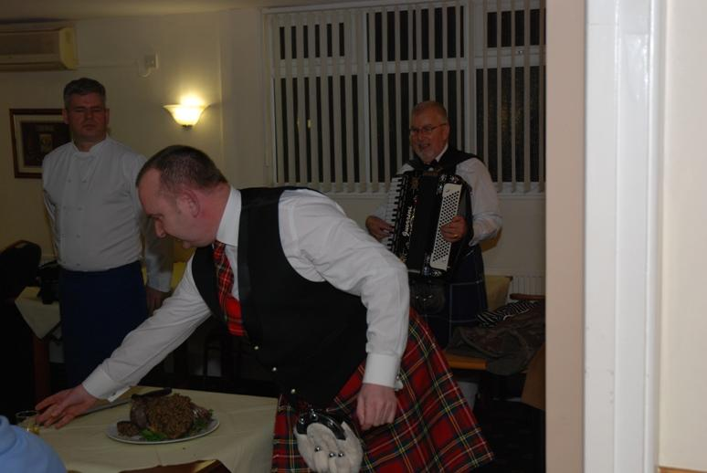 BURNS NIGHT - 2016 - Thank God. He's put the knife down to take a tot to toast his old friend Robbie.
