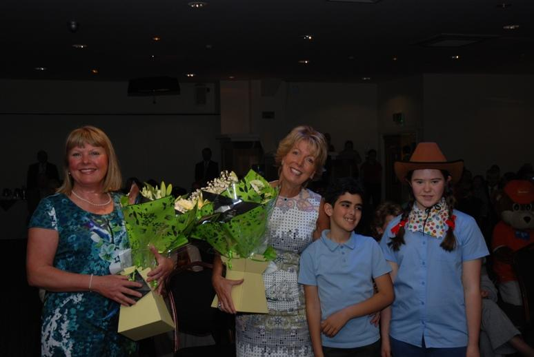 SPECIAL SCHOOLS MUSIC FESTIVAL 2015 - Janet Harrison and Janet Livock from Ribby Hall with their bouquets and the youngsters who presented them.