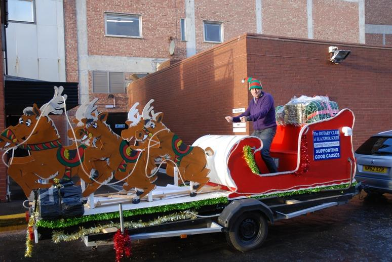 SANTA VISITS THE HOUNDSHILL CENTRE, BLACKPOOL - Roger is practising in case he has to drive the reindeers.