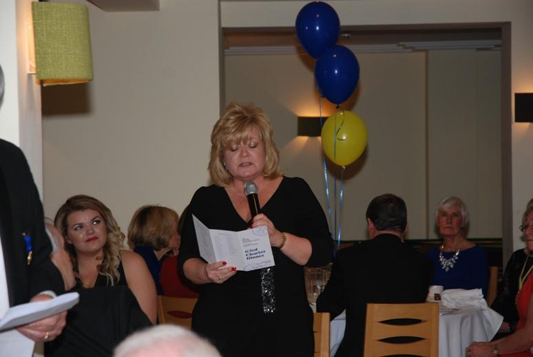 CHARTER DINNER 2015 - Past President Jacqui Longden reads the 'Object of Rotary'.