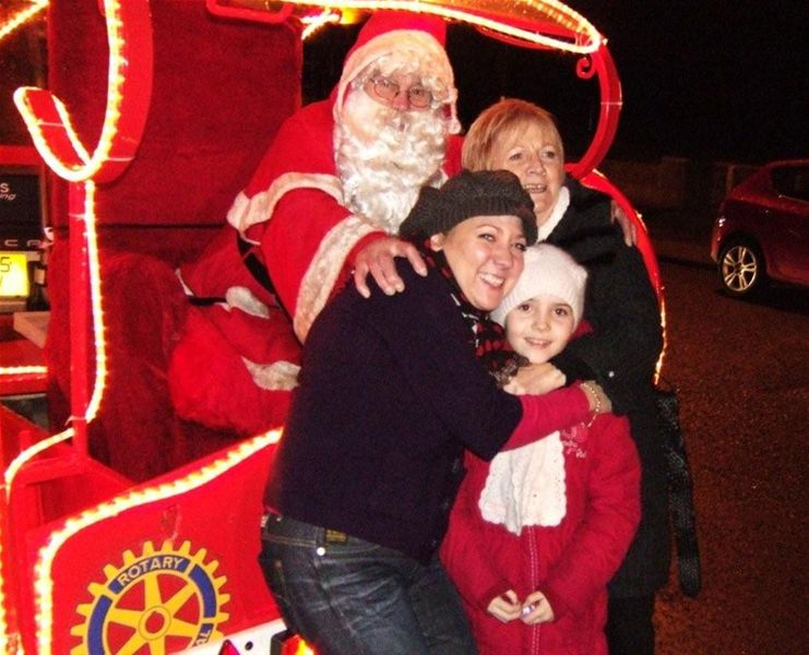 Santa Christmas Sleigh collections - A youngster and two mums enjoy chatting to Santa.
