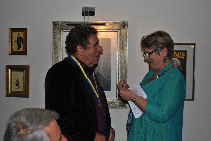 7.15 for 7.30pm Sheila's President's night at the Castle Inn - Getting the badge out of the packet...