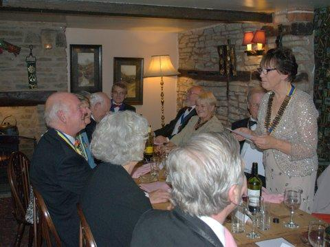 President's evening at the Riverside Inn, Aymestry - Dorothy reads out her winning poem.....
