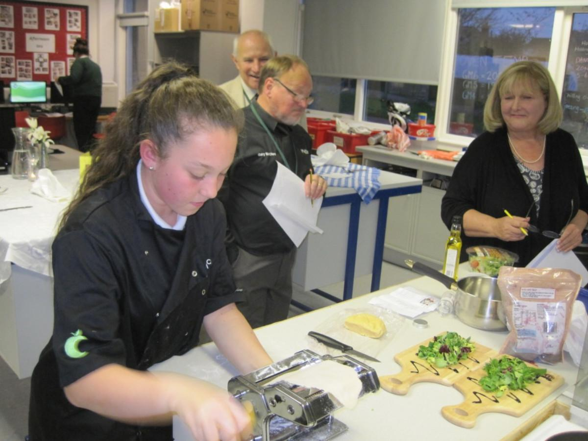 Rotary Young Chef competition 2016  - Sue Day admires Charlotte's eye for detail.