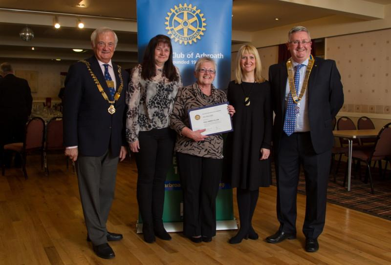 Club Photo Gallery July 2015 to June 2016 - Sheila Ratcliffe (centre) receives a posthumous Paul Harris Award in respect of her late husband Jim Ratcliffe. Jim's daughters Alison (L) and Vicky (R) look on