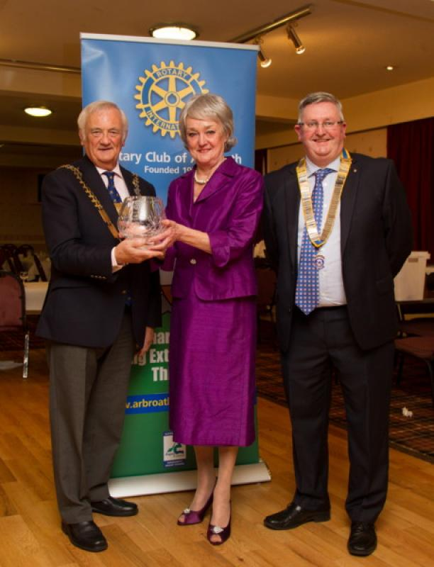 Club Photo Gallery July 2015 to June 2016 - Sheena Glover receives the Arbroath Citizen of the Year Award from District Governor Mike Halley (L) and Club President David Miller (R)