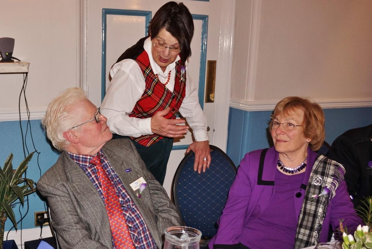 Burns Night at Pinner Hill Golf Club - MC Anne checking on the guests