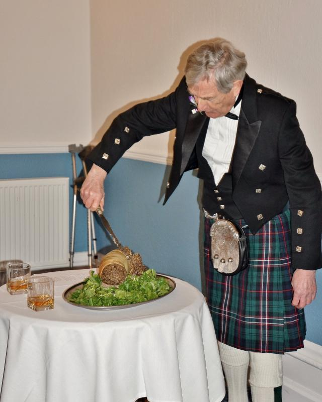 Burns Night at Pinner Hill Golf Club - ... and attacks the haggis ....