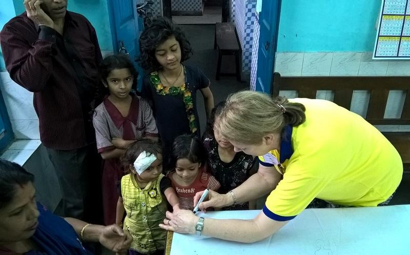 What we are doing internationally - One of the team of five Cheadle & District Rotarians, Marian Basu in India administering Polio vaccinations. Feb 2016