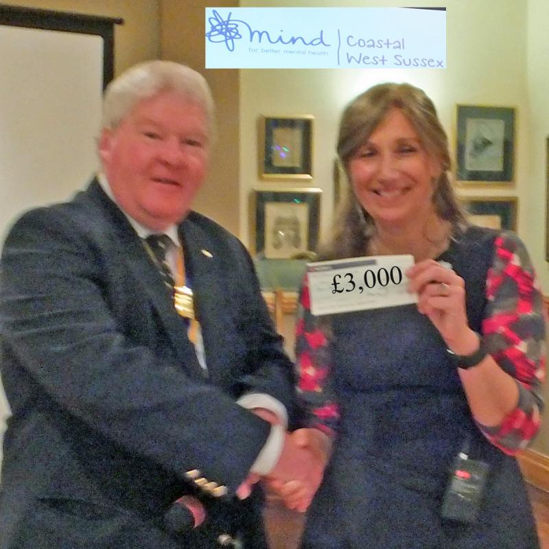 2016/17 Speakers at M&P - President Robert Morrison hands Toni Holloway of Mind a cheque £3,000
