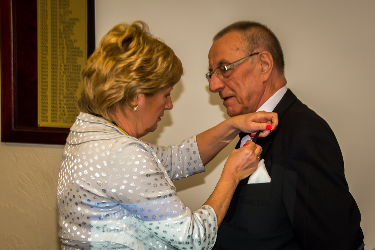 The Rotary Foundation centenary celebration. - Neil is presented with his PHF pin.
